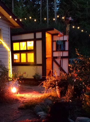 Tiny Timber Frame Office with stained glass windows -- so magical at night.
